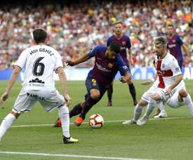Luis Suarez in action for Barcelona against Huesca. AFP