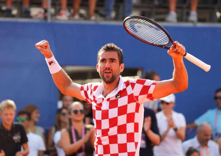 El croata Marin Cilic celebra la victoria conseguida ante el estadounidense Frances Tiafoe. EFE