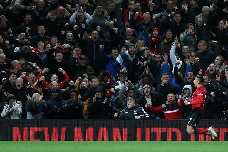 Alexis Sanchez scored a late header to give United their first home win since August. AFP