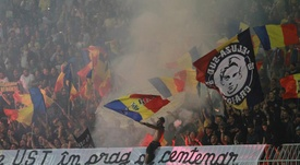 Romania have been charged with misconduct and racism by UEFA. AFP