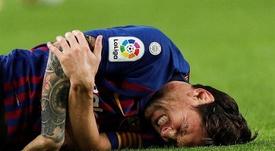 Messi sofreu uma lesão no braço contra o Sevilla. EFE