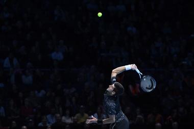 El tenista sudafricano Kevin Anderson celebra tras vencer al japonés Kei Nishikori durante su encuentro perteneciente a las Nitto Finales ATP disputado en Londres, Reino Unido. EFE