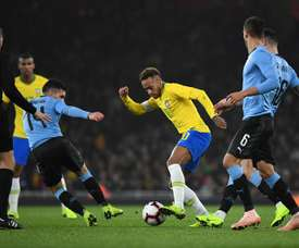 Brazil's Neymar vies for the ball with Uruguay's Lucas Torreira. EFE