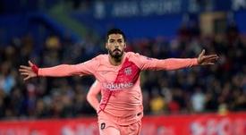 Suarez, ravi de la prestation de Messi. EFE