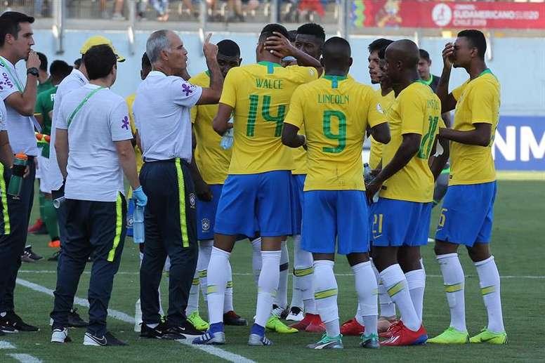Carlos Amadeu comemora 'participação' na seleção de Tite. EFE