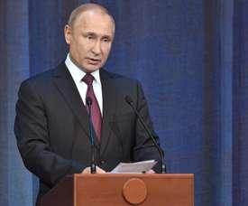 Putin homenajeó a Infantino. EFE