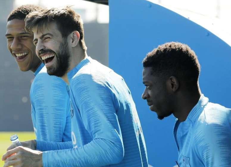 Vidal se reincorpora al grupo en una sesión con Piqué. EFE