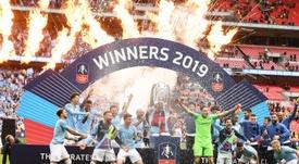 Premiação espetacular para o Manchester City pela tríplice coroa. EFE/EPA