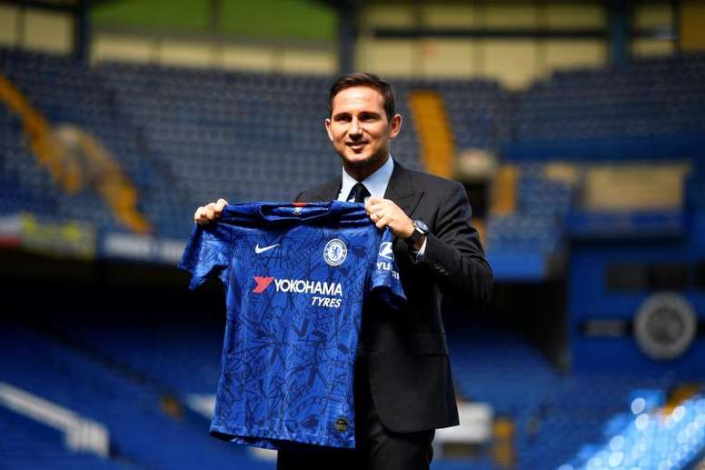 Frank Lampard holds a Chelsea's jersey after attending a press conference at Stamford Bridge in London, Britain. EFE