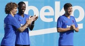 El Barça negocia con Busquets, Griezmann y Sergi Roberto. EFE
