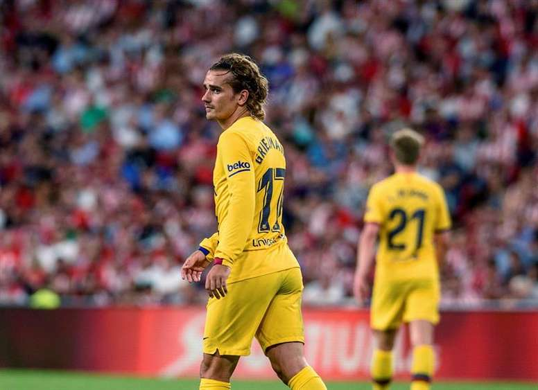 Atletico withdraw their complaint to La Liga about Barcelona and Griezmann . AFP