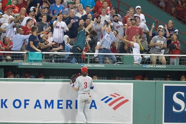 Philadelphia Phillies right fielder Bryce Harper watches as fans reach for the home run hit by Boston Red Soxs Jackie Bradley Jr. during the second inning of the MLB baseball game between the Boston Red Sox and the Philadelphia Phillies at Fenway Park in Boston, Massachusetts, USA, 21 August 2019. EFE/EPA/CJ GUNTHER