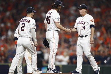 Houston Astros manager A.J. Hinch (R) removes pitcher Gerrit Cole (2R) from the game in the top of the eighth inning of their MLB American League Divsion Series playoff baseball game two at Minute Maid Park in Houston, Texas, USA, 05 October 2019. EFE/EPA/LARRY W. SMITH