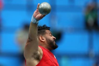 El atleta español Kim López González compite en la prueba masculina de lanzamiento de peso F12. EFE/Marcelo Sayão/Archivo