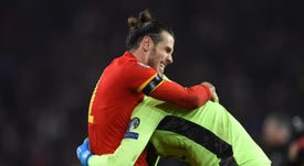 Bale (L) has become a hinderance for Real Madrid. EFE/Peter Powell