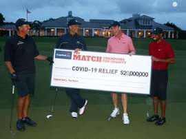 A handout photo made available by Getty Images for the Match shows United States golfer Tiger Woods (R) and former National Football League (NFL) player Peyton Manning (2-R) celebrating defeating golfer Phil Mickelson of the US (L) and NFL player Tom Brady of the Tampa Bay Buccaneers (2-L) on the 18th green during The Match: Champions for Charity at Medalist Golf Club in Hobe Sound, Florida, USA, 24 May 2020. EFE/MIKE EHRMANN