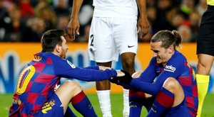 Something is up with Griezmann and Messi. EFE