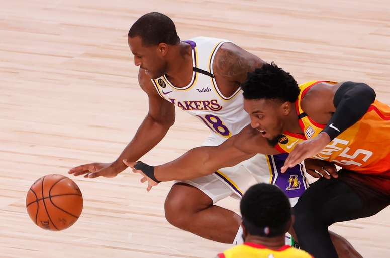 Los Angeles Lakers guard Dion Waiters (L) and Utah Jazz guard Donovan Mitchell battle for the ball in the third quarter of the NBA basketball game between the Los Angeles Lakers and the Utah Jazz at the ESPN Wide World of Sports Complex in Kissimmee, Florida, USA, 03 August. EFE/EPA/ERIK S. LESSER