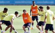 Messi treinou sem proteções no tornozelo. EFE