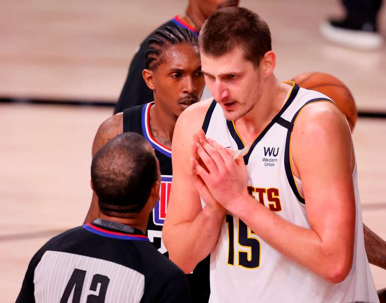 Denver Nuggets center Nikola Jokic (d) EFE/EPA/ERIK S. LESSER