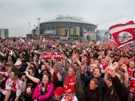 Ajax Amsterdam fans celebrate at the Ajax Arena Park in Amsterdam on May 3, 2012