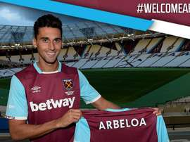 Arbeloa poses for photos at his new club's stadium. WestHam