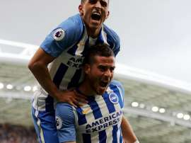 Knockaert celebrates with Tomer Hemed. Twitter/BHAFC