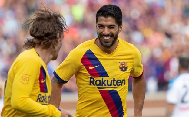 El ex agente de Griezmann desveló las llamadas de Suárez, Piqué y Messi para seducirle. EFE