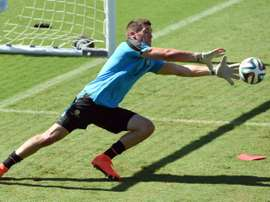 Australia goalkeeper Matthew Ryan makes a save during a training session in Vitoria, Brazil, on June 9, 2014