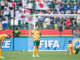 Australian players react to their 1-0 loss to Japan after their quarter-final football match in Edmonton, Alberta on June 27, 2015