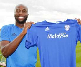 Bamba poses with the Cardiff City shirt. CardiffCityFC