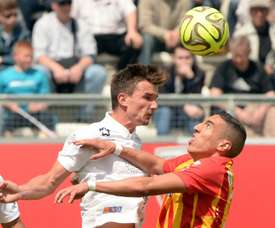 Benjamin Stambouli (left), playing for Montpellier, outjumps Lens Alharbi El Jadeyaoui in a Ligue 1 match in Amiens on May 10, 2015