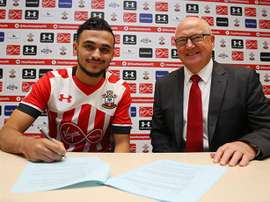 Boufal is pictured signing his Southampton contract. SainstFC