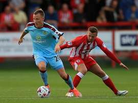 Burnley's Ulvestad is closely watched by Accrington Stanley's Hewitt. BurnleyFootballClub