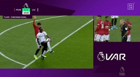 VAR didn't see United's foul... But it did catch Mane's handball. Screenshot/DAZN