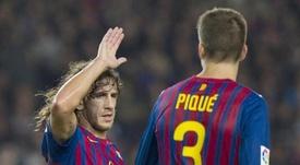 Carles Puyol alabó a Gerard Piqué. EFE