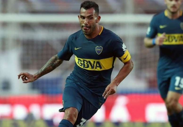 Tevez is anything but a football fanatic. AFP