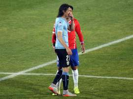 Chile football team defender Gonzalo Jara (back) provokes Uruguay Edinson Cavani (front) during their Copa America 2015 quarterfinals football match in Santiago