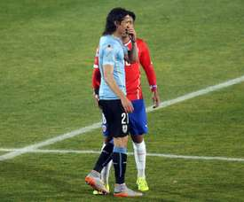 Chile Gonzalo Jara (back) provokes Uruguay Edinson Cavani (front) during their Copa America 2015 quarterfinals football match in Santiago, on June 24, 2015