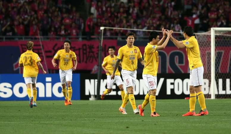 China Guangzhou Evergrande players celebrate after scoring a goal during an AFC Champions League match in Osaka, in May 2014