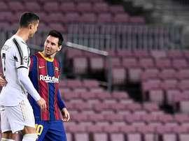 Cristiano Ronaldo e Leo Messi foram alvo de comparação feita por Arthur. AFP