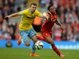 Crystal Palace Scottish midfielder James McArthur (L) during the English Premier League football match against Liverpool on May 16, 2015