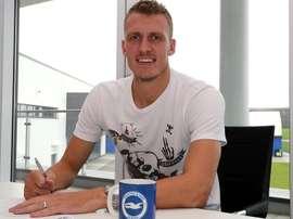 Dan Burn signs his Brighton contract. Twitter/OfficialBHAFC