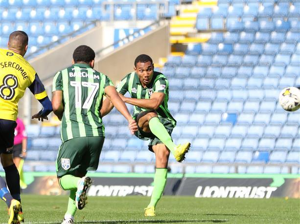 Darius Charles scores against Oxford United. AFCWimbledon