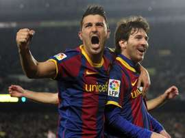 Villa pictured with Messi. AFP