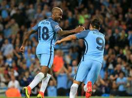 Delph celebrates his goal with Nolito. ManCity