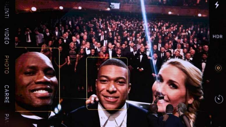 Drogba took a selfie with everyone. AFP