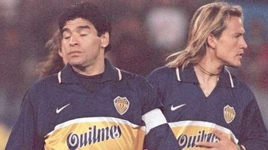 Diego Maradona (L) used to play for Boca juniors. AFP