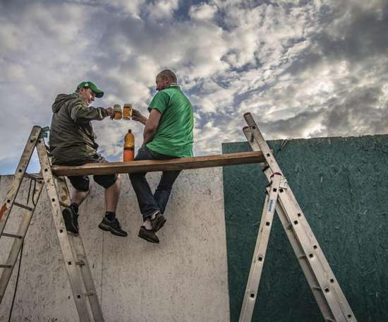Scaffolding and ladders were used to watch the derby. EFE/EPA/Martin Divisek
