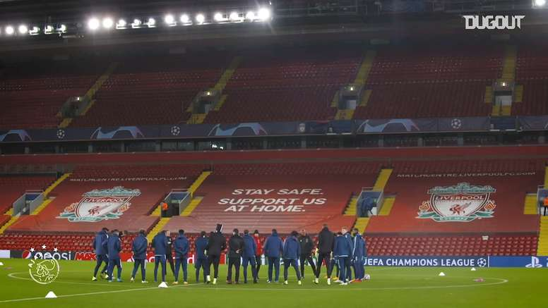 Ajax stars train on Anfield pitch. DUGOUT